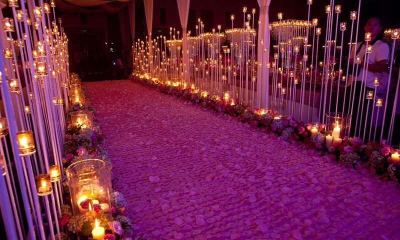 Purple Christmas wedding aisle lined with candles