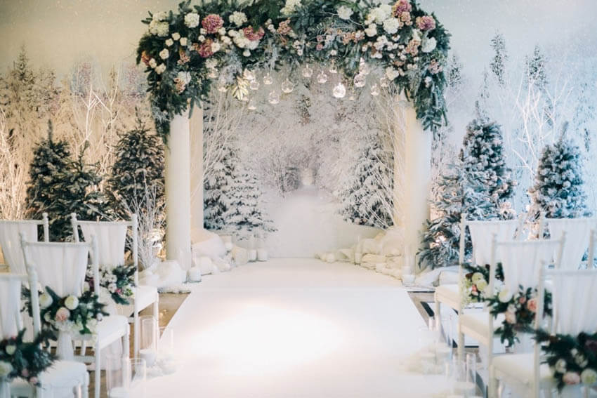 Snowy white winter themed wedding aisle