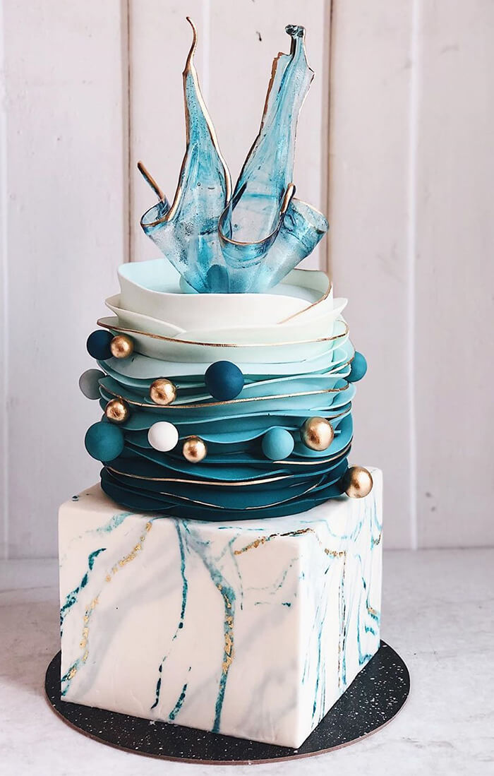 teal, navy, gold and white marble cake